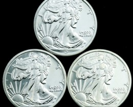 Silver .9999   Three ½ ounce American walking liberty rounds