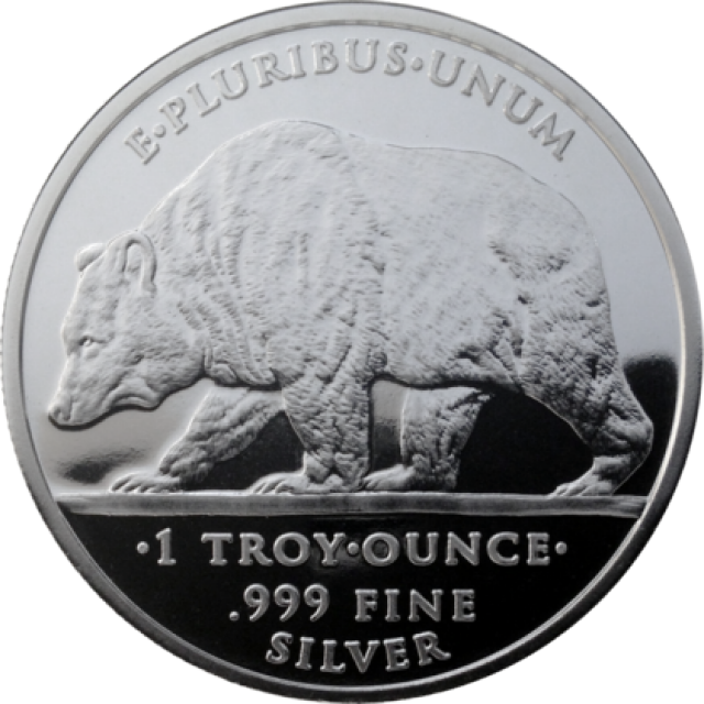 one ounce Prospector and Bear silver round