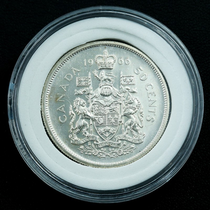 Silver .800 1966 Canadian silver half dollars in capsule