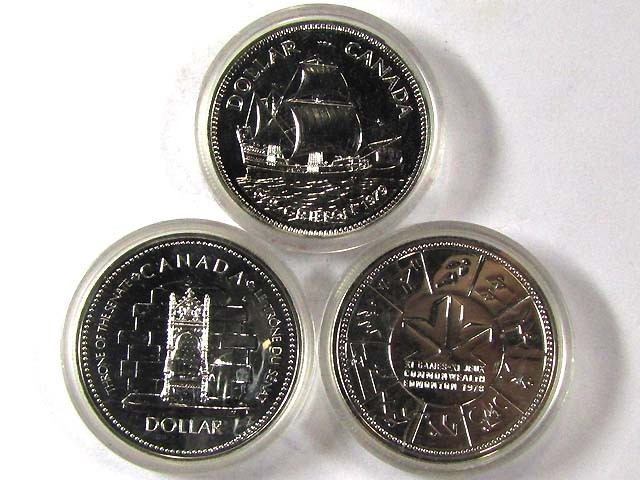 THREE SILVER CANADIAN COINS IN CAPSULE 1977 - 79