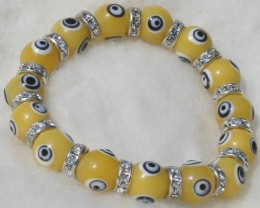 Yellow bead Evil Eye bracelet with rhinestone spacers new