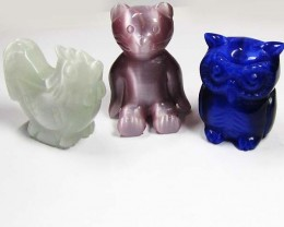 THREE DAZZLING CARVINGS (SYNTHETIC) 534  CARATS   PG114
