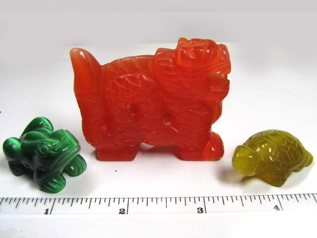 THREE DAZZLING CARVINGS (SYNTHETIC)  436 CARATS   PG110