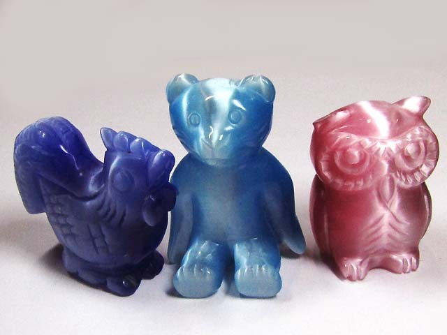 THREE DAZZLING CARVINGS (SYNTHETIC)  558 CARATS   PG115