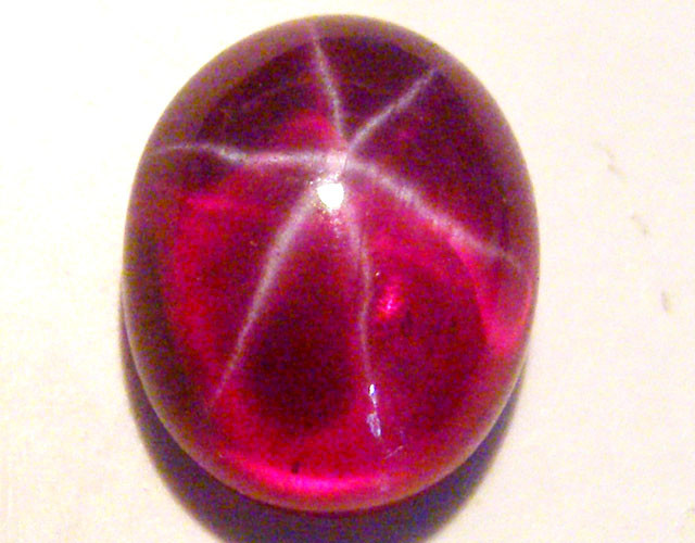 CAB TREATED STAR RUBY $5.00 PER CARAT  4.55 CT RM 617