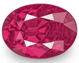 IGI Certified Mozambique Ruby, 0.92 Carats, Fiery Vivid Purplish Red Oval