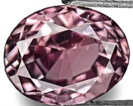 Madagascar Pink Sapphire, 0.68 Carats, Brownish Purplish Pink Oval