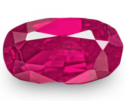 IGI Certified Tajikistan Ruby, 0.63 Carats, Fiery Pinkish Red Oval