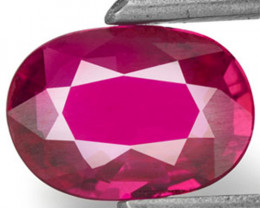 Mozambique Ruby, 0.71 Carats, Magenta Red Oval