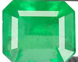 Colombia Emerald, 0.77 Carats, Fluorescent Green Emerald Cut