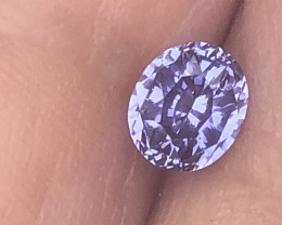Very brightly cut full of flash sapphire very clean looking.  Only light heat.