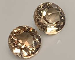 A PAIR OF SILVER GOLD TOPAZ GEMS - 6.80mm Jewellery grade gems