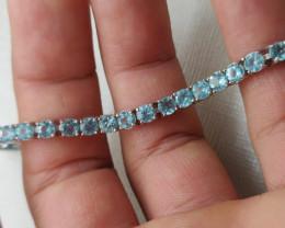 (9) Gorgeous Nat 57.85tcw. AAA Neon Blue Apatite Bracelet