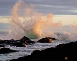 Sunset waves on rocks.
