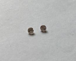 0.05 CTW very light pinkish purple diamond pair