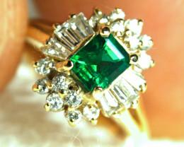 24.79 Tcw. 18K Gold, Emerald + 1 tcw. Diamond Accents - Sz. 6