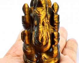 Genuine 785.00 Cts Golden Tiger Eye Ganesha Idol