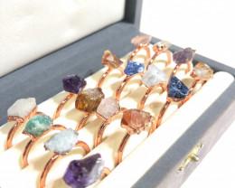 16 Raw Gemstones in copper rings Br 2451