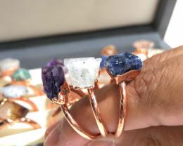 16 Raw Gemstones in copper rings Br 2448