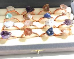 16 Raw Gemstones in copper rings Br 2446