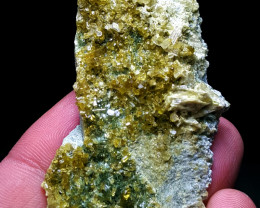 Amazing Damage free Epidote cluster combine with Diposite 205 Cts-P