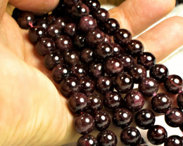 719.0  Tcw. 46.5 Inches 8mm Garnets - Gorgeous