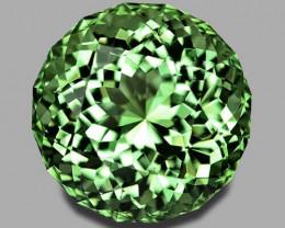Flawless, exquisite precision round brilliant cut neon green tourmaline.