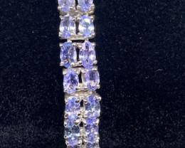 (9) Stunning 23.84tcw. Blue Violet Tanzanite Bracelet Untreated