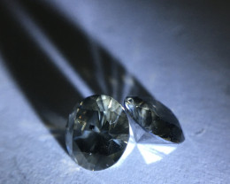 1.3 ctw fancy yellowish greenish grey Round brilliant diamond pair