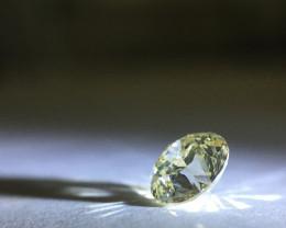 0.68 carat U-V - fancy light yellow I3 round brilliant diamond
