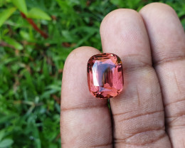 Nice pinkish orange tone with a very reflective cut stone.   Looks loupe clean upon quick examination.  I looked a couple times.   VVS quality or better.