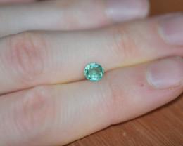 0.88ct SI bluish-green Paraiba T.  Cert.