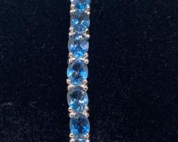 (12) Precious  10.66tcw.  London Blue Topaz  Bangle