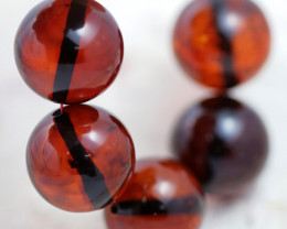 38 Cts Red Amber Beads 14 mm    AM 1616