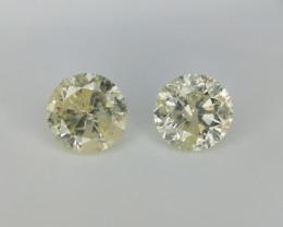 0.96 cts , Pair Of yellow Diamonds , Round Brilliant Cut