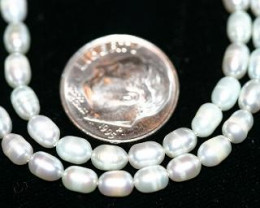 2 STRANDS WHITE FRESH WATER PEARLS - 128 CARATS