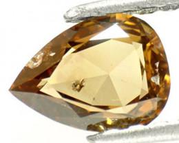 Guinea Fancy Color Diamond, 0.61 Carats, Orangish Champagne Pear