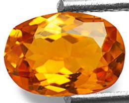 Tanzania Clinohumite, 0.73 Carats, Vivid Orange Oval