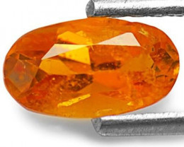 Tanzania Clinohumite, 0.73 Carats, Intense Orange Oval