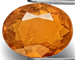 Tajikistan Clinohumite, 4.02 Carats, Intense Orange Oval