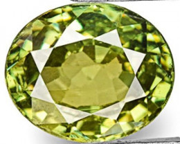 Namibia Demantoid Garnet, 0.65 Carats, Vivid Yellowish Green Oval