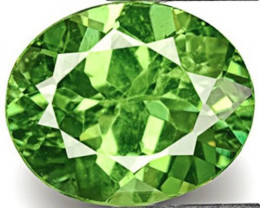Namibia Demantoid Garnet, 0.81 Carats, Fiery Yellowish Green Oval