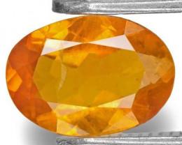 Tajikistan Clinohumite, 0.63 Carats, Yellowish Orange Oval