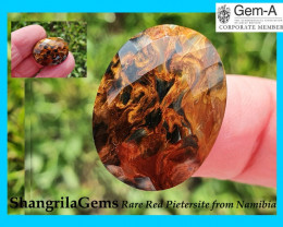 23mm 16.6ct red Pietersite cabochon faceted oval 23 by 17 by 5mm