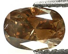 Guinea Fancy Color Diamond, 0.73 Carats, Orangish Champagne Oval