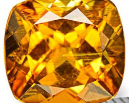 Tanzania Clinohumite, 0.97 Carats, Neon Golden Orange Cushion