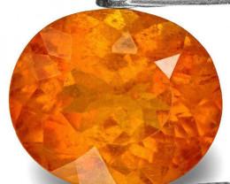 Tajikistan Clinohumite, 3.55 Carats, Lustrous Intense Orange Oval