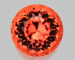Flawless, custom precision round cut vivid pinkish orange tourmaline.