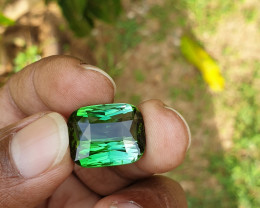 23.92 ct bi color bluish green to vivid green.  DRC.