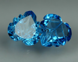 7.995 CRT LOVELY SWISS BLUE TOPAZ CARVING-